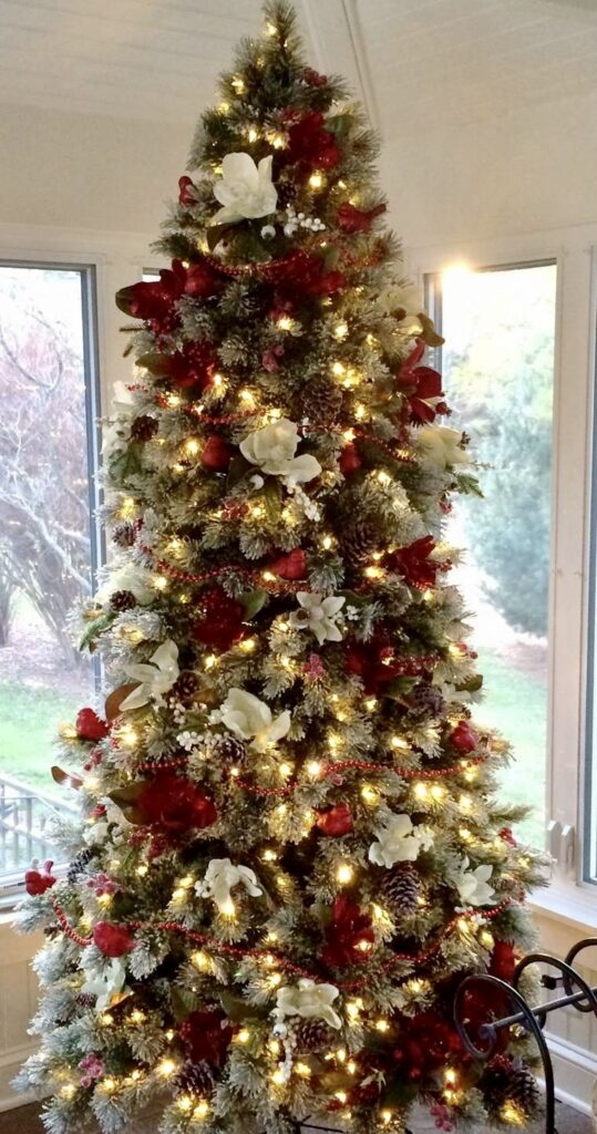 beautifully decorated christmas tree with reds and whites