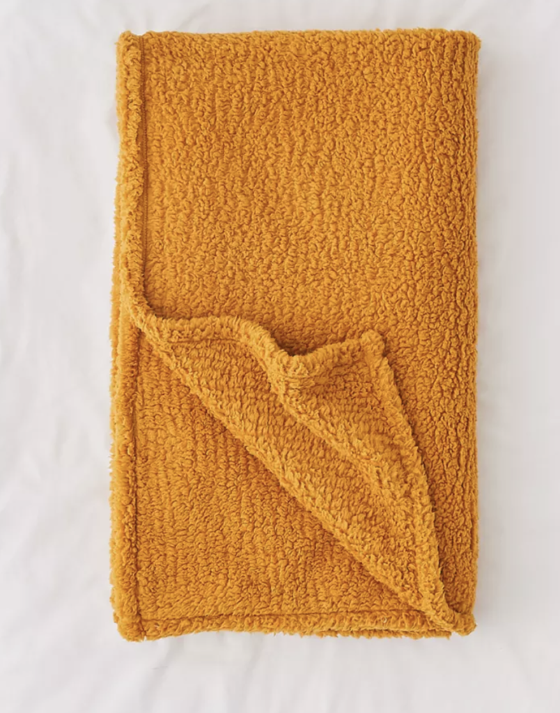 rusty orange soft throw for an apartment bed or couch